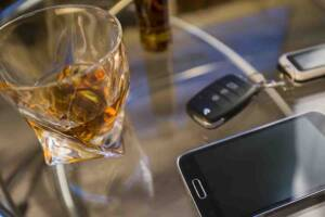 alcohol, keys, smartphone